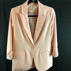 Light pink blazer.
